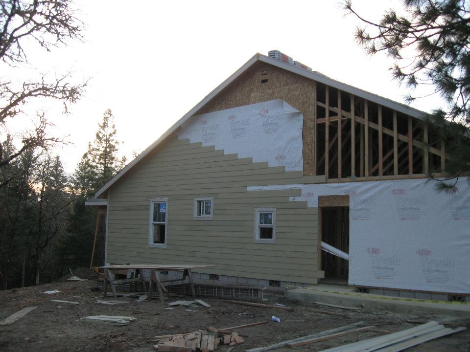 Side View of new home in Paradise Vista lot 16- siding installation