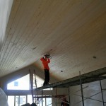 Finish trim of Knotty Pine ceiling in the Great Room