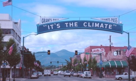 "photo of ""it's the climate"" banner in Grants Pass"